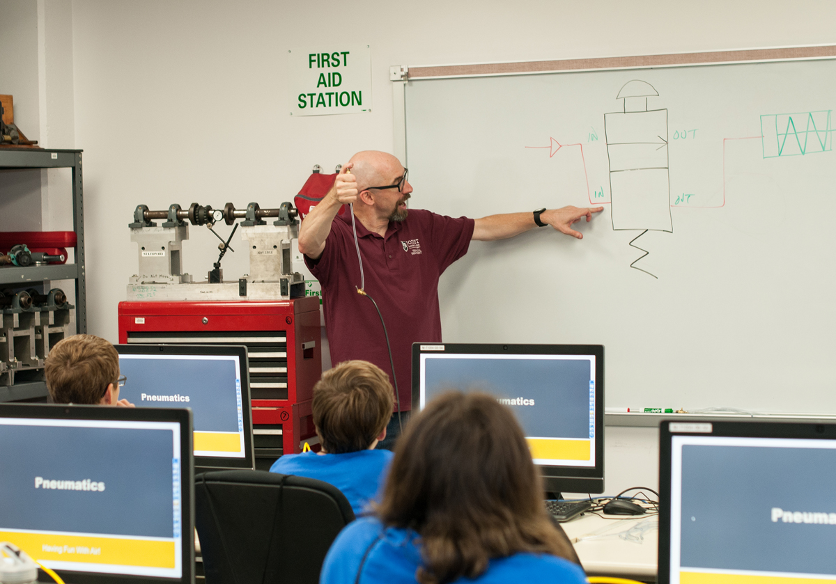 JJC Technical Professor Dr. Jeff Bradford at white board during Technology Camp